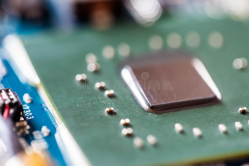 Concept of computer Technology: Close up of a computer chip on a circuit board. Computer chip on a circuit board, close up; Computer technology artificial stock photos