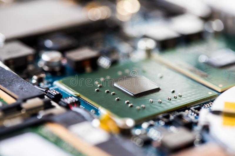 Concept of computer Technology: Close up of a computer chip on a circuit board. Computer chip on a circuit board, close up; Computer technology artificial royalty free stock photo