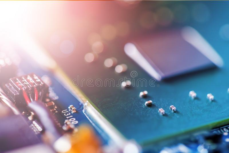 Concept of computer Technology: Close up of a computer chip on a circuit board, sunbeam. Computer chip on a circuit board, close up; Computer technology stock photo