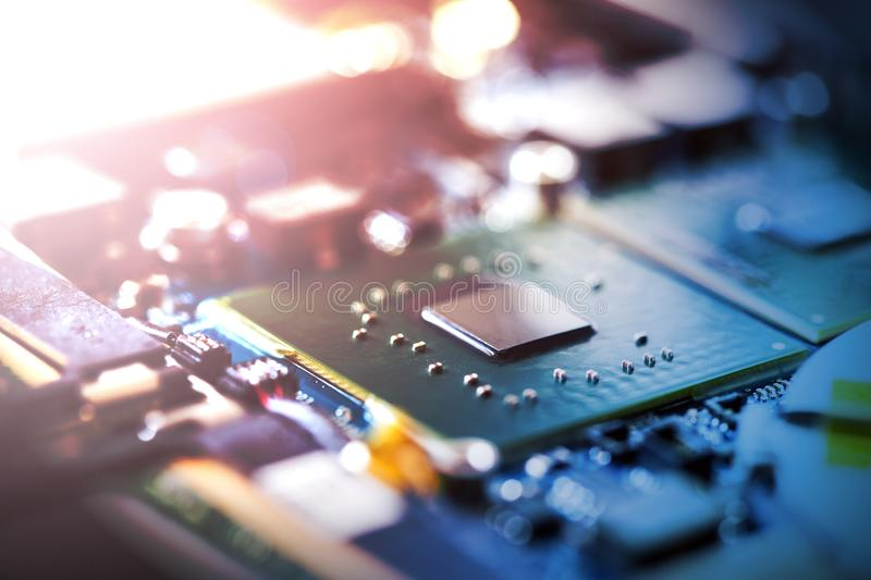 Concept of computer Technology: Close up of a computer chip on a circuit board, sunbeam. Computer chip on a circuit board, close up; Computer technology stock photos