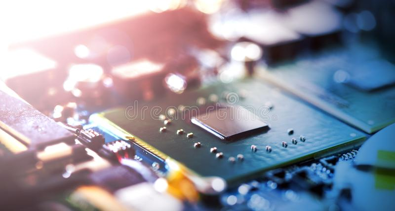 Concept of computer Technology: Close up of a computer chip on a circuit board, sunbeam. Computer chip on a circuit board, close up; Computer technology royalty free stock images