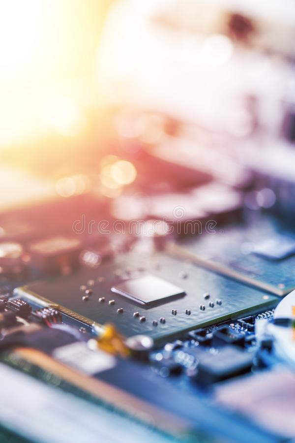 Concept of computer Technology: Close up of a computer chip on a circuit board, sunbeam. Computer chip on a circuit board, close up; Computer technology royalty free stock photo