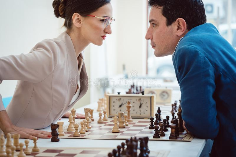 Concept of confrontation, businesspeople playing chess stock photo