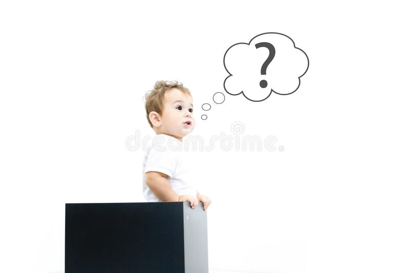 Concept for confusion, inspiration and solution. little boy looks out of the box, looking for the answer, the question mark, the. Child asks questions stock images