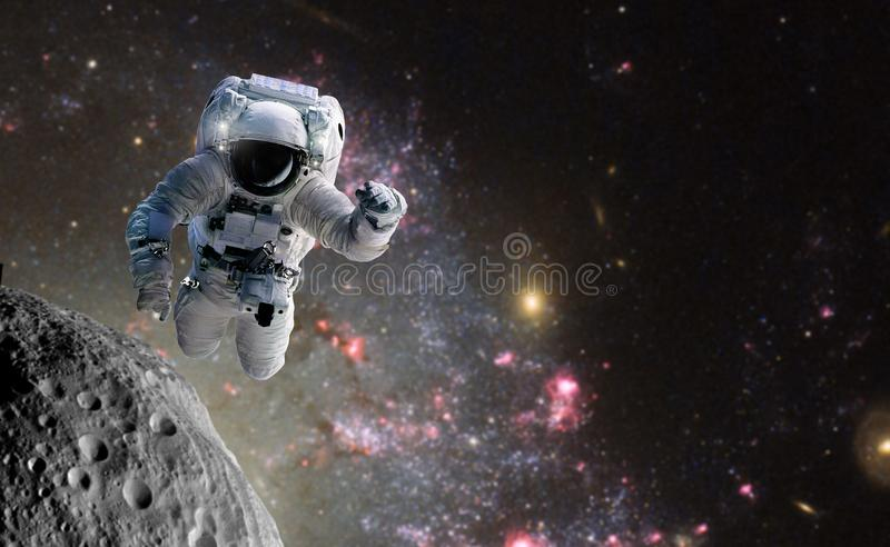 Concept of conquering the universe by the human race. Elements of this image furnished by NASA. Astronaut at spacewalk. Concept of conquering the universe by the stock photos
