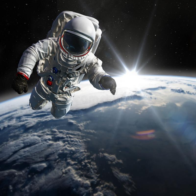 Concept of conquering the universe by the human race. Elements of this image furnished by NASA. Astronaut at spacewalk. Concept of conquering the universe by the stock image