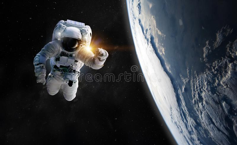 Concept of conquering the universe by the human race. Elements of this image furnished by NASA. Astronaut at spacewalk. Concept of conquering the universe by the royalty free stock images