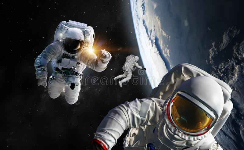 Concept of conquering the universe by the human race. Elements of this image furnished by NASA. Astronaut at spacewalk. Concept of conquering the universe by the stock photography