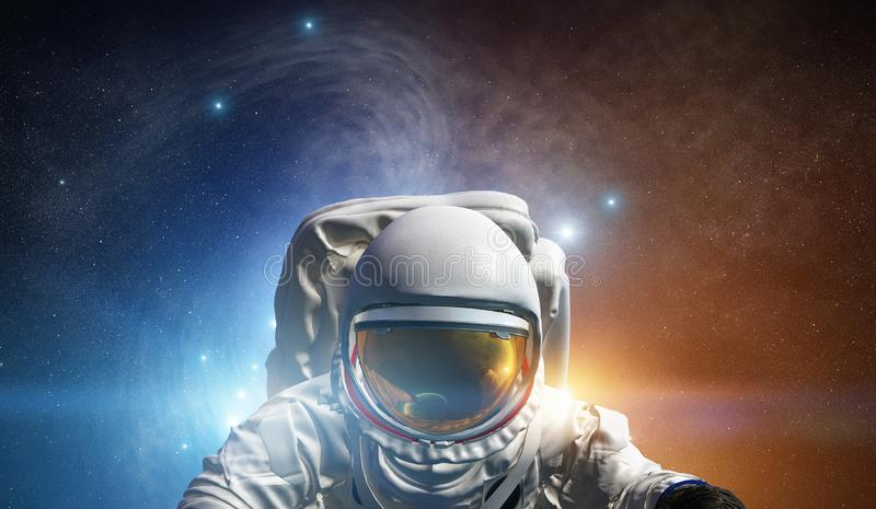 Concept of conquering the universe by the human race. Elements of this image furnished by NASA. Astronaut at spacewalk. Concept of conquering the universe by the stock photo