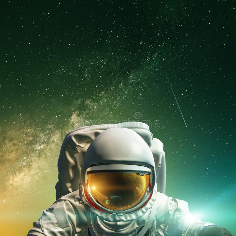 Concept of conquering the universe by the human race. Elements of this image furnished by NASA. Astronaut at spacewalk. Concept of conquering the universe by the royalty free stock photo