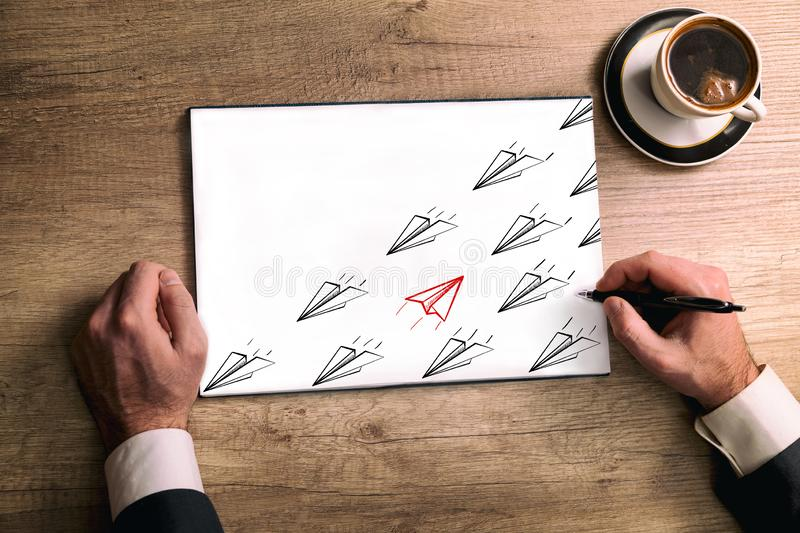Concept of contradiction. Sketch paper airplanes fly to an opposite direction. Red  sketch paper airplanes fly in opposite direction from black sketch paper stock photography