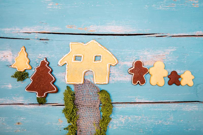 Concept with cookies, bake a intercultural and multiracial family and a starter house royalty free stock images