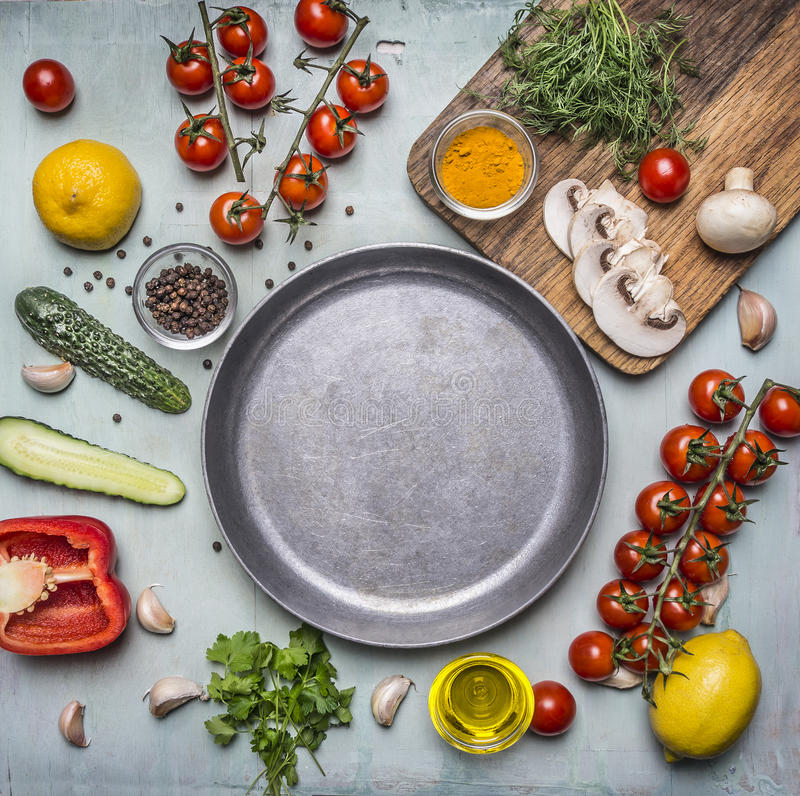 Concept cooking vegetarian food ingredients laid out around the pan with spices, mushrooms, butter wooden rustic background top. Concept cooking vegetarian food royalty free stock image