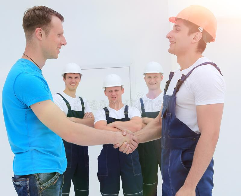 Handshake of the architect and engineer stock images