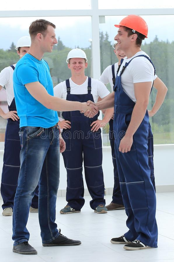 Handshake of the architect and the superintendent royalty free stock photo