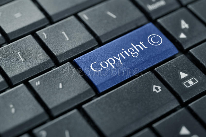 Concept of Copyright. Computer keyboard with Copyright symbol closeup royalty free stock photography