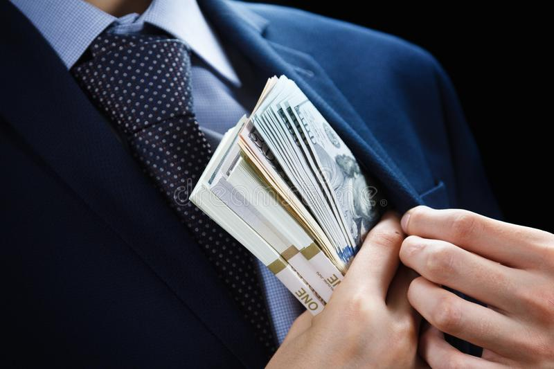 Concept for corruption, finance profit, bail, crime, bribing, fraud. Bundle of dollar cash in hand. royalty free stock photography