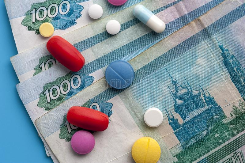 Concept Of Costs on Health Promotion And Medical Treatment. Multicolored Pills on One Thousand Rubl Bills. Concept Of Costs on Health Promotion And Medical royalty free stock photos