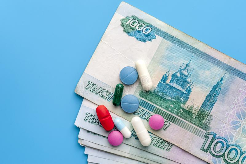 Concept Of Costs on Health Promotion And Medical Treatment. Multicolored Pills on One Thousand Rubl Bills. Concept Of Costs on Health Promotion And Medical stock image
