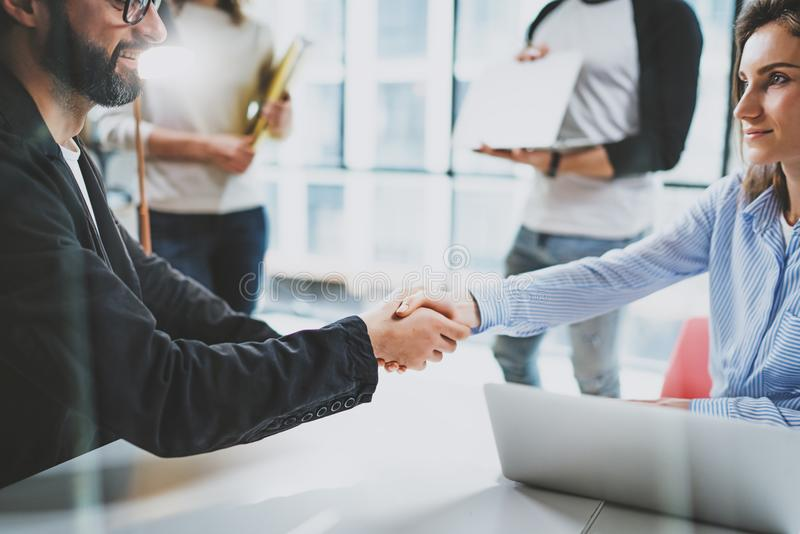 Concept coworkers team handshaking process.Business partnership handshake.Successful deal after great meeting at sunny royalty free stock photography