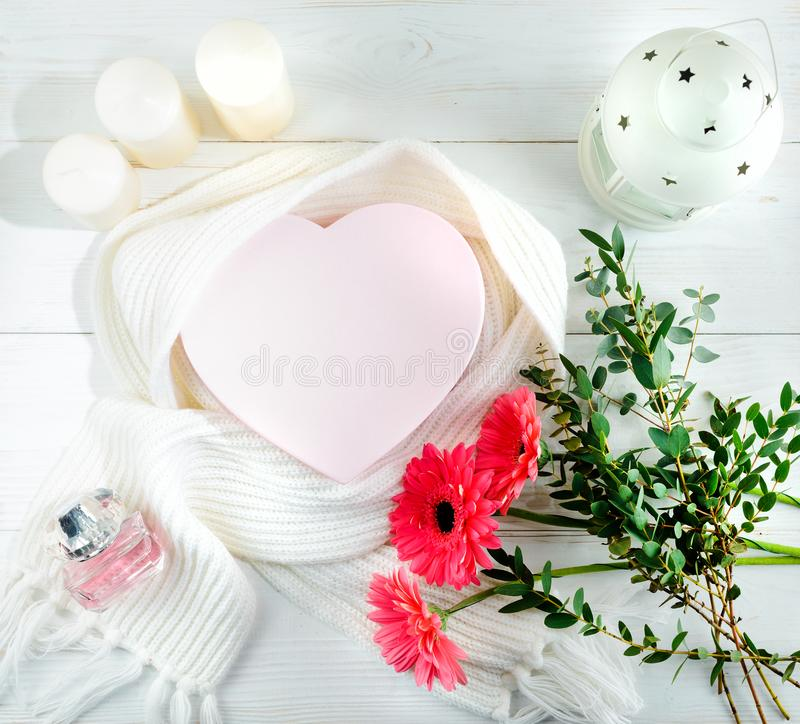 Concept of coziness and warm winter day. White scarf, box in the stock image