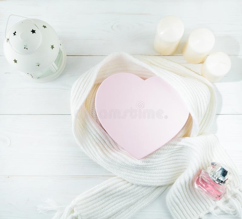 Concept of coziness and warm winter day. White scarf, box in the stock images