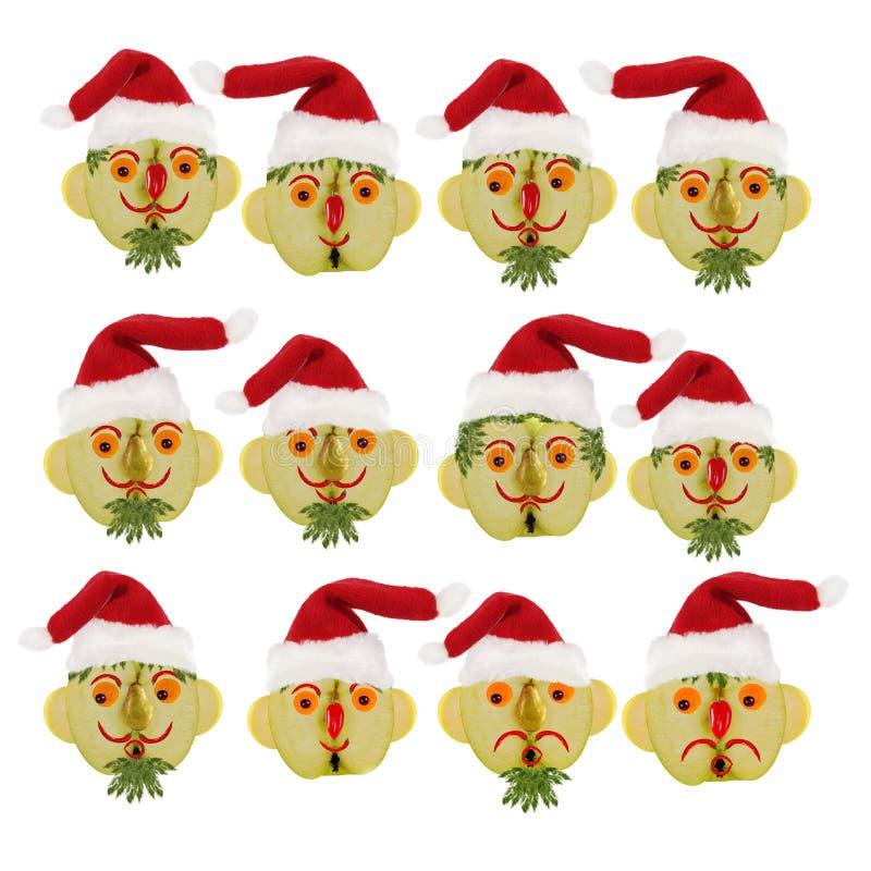 Concept créatif d'alimentation Peu de portraits amusants d'un Père Noël à partir de légumes et de fruits photo stock