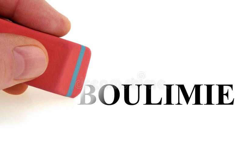 Concept of cure of bulimia. Clear the word bulimia with an eraser stock photos