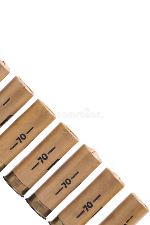 Concept d'une cartouche d'un fusil de chasse sur un fond blanc images stock