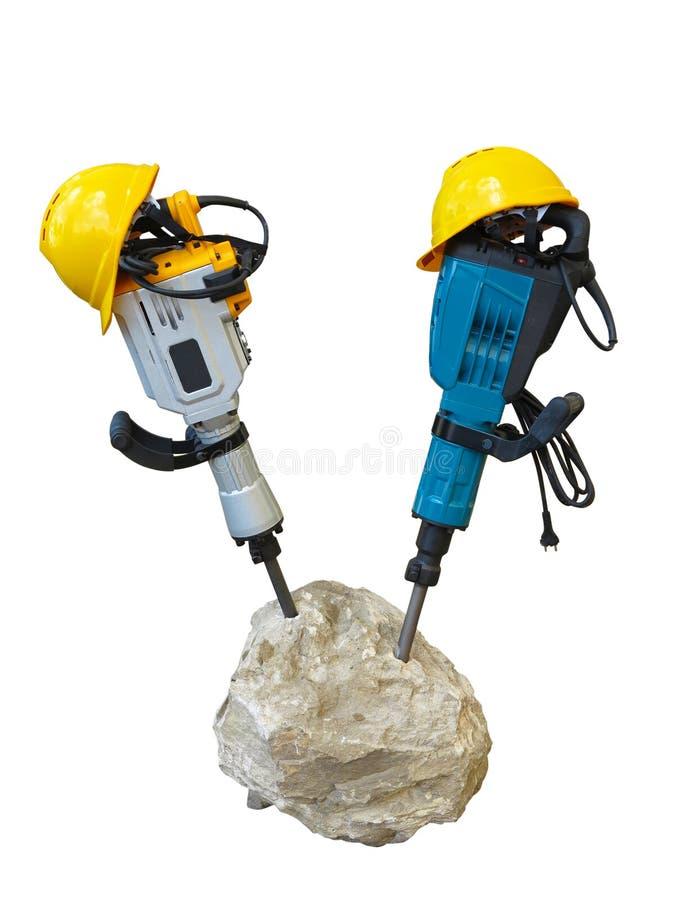 Concept de construction - marteau piqueur dans le casque concret et jaune photos stock