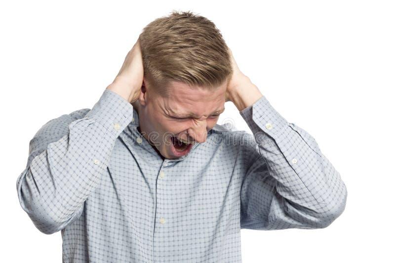 Homme d'affaires désespéré criant avec des mains à la tête. image libre de droits