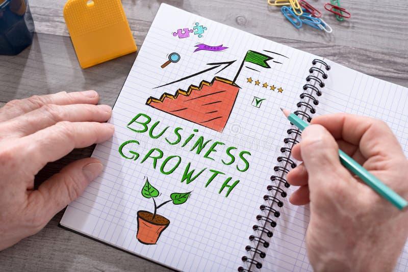 Concept de croissance d'affaires sur un bloc-notes photos libres de droits