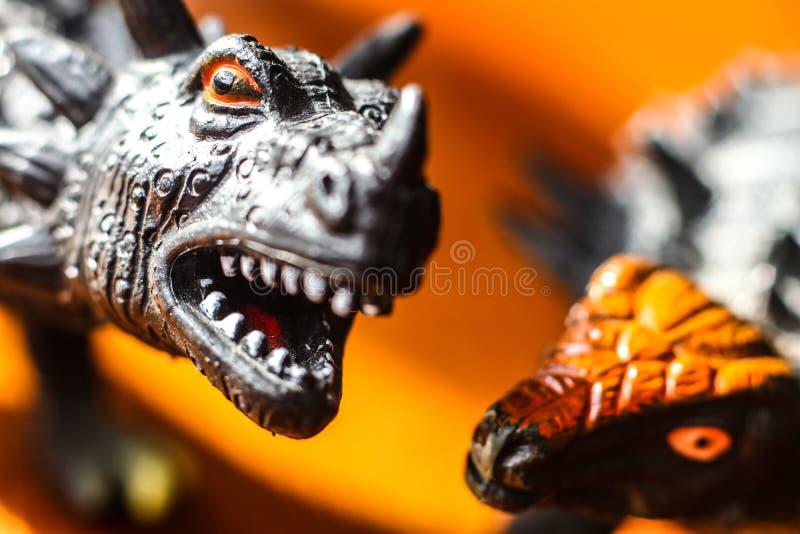 Concept de domination des dinosaures de jouets en caoutchouc image stock