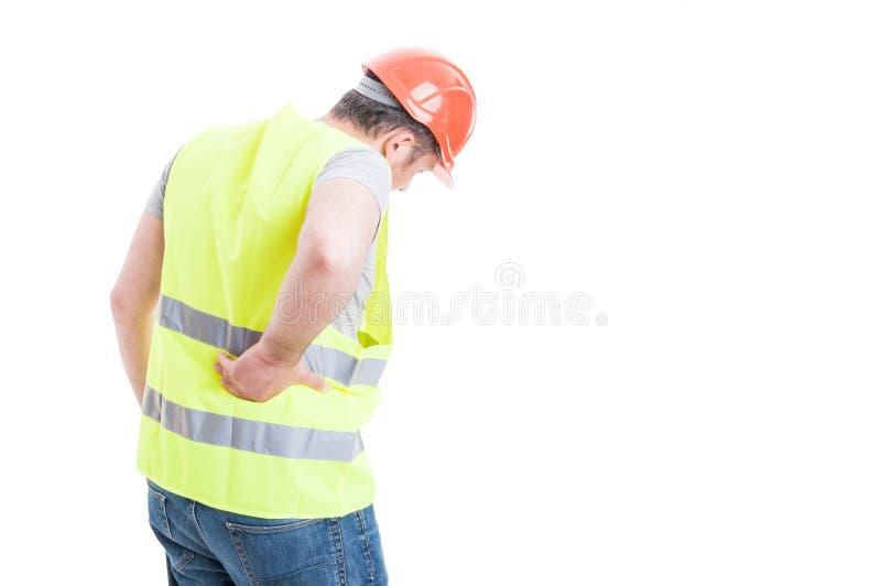 Concept de douleurs de dos avec le constructeur avec la blessure de torse photo stock