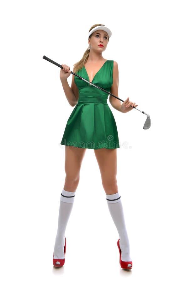 Concept de golf Joueur de golf heureux de femme tenant le regard de club de golf photographie stock