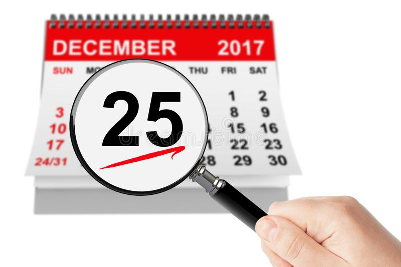 Concept de jour de Noël 25 décembre 2017 calendrier avec la loupe photographie stock