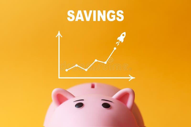 Concept de l'épargne tirelire avec le diagramme photos stock
