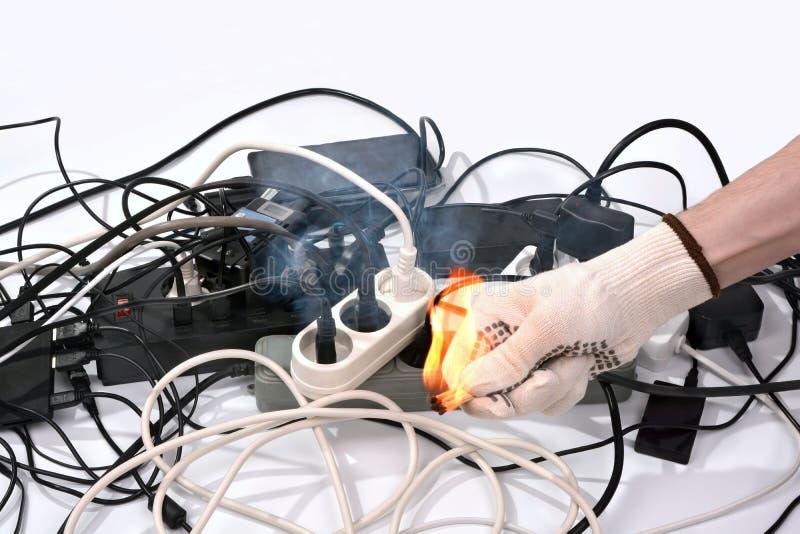 Concept de l'allumage des câbles de la surchauffe d'un Ne électrique photographie stock libre de droits