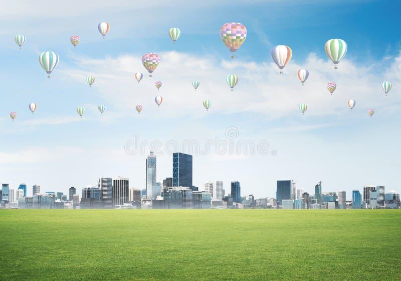 Concept de la vie de vert d'eco avec des aérostats volant au-dessus de la ville images stock