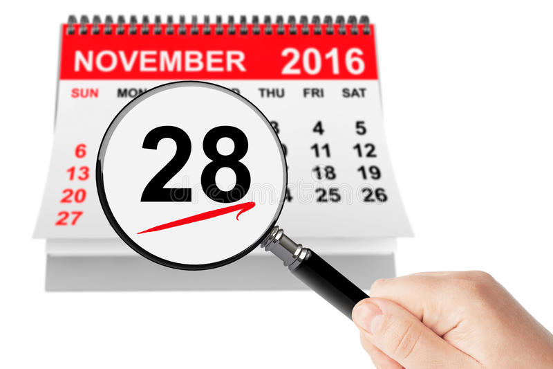 Concept de lundi de Cyber 28 novembre 2016 calendrier avec la loupe photos stock