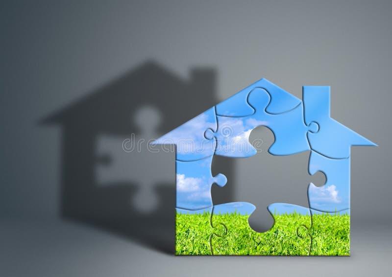 Concept de maison verte d'Eco, maison faite à partir du puzzle sur le gris image stock