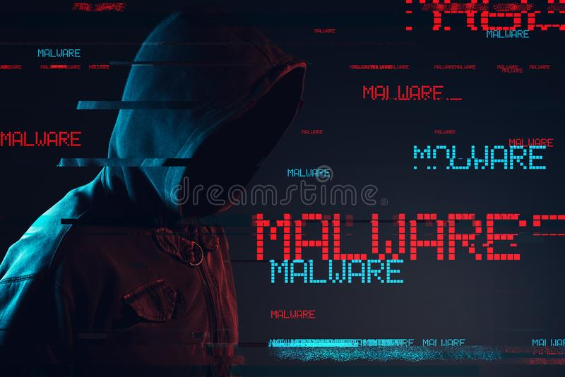 Concept de Malware avec la personne masculine à capuchon sans visage photographie stock