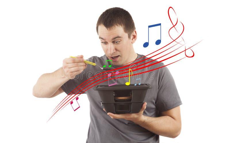 Concept de mens die muziek eten stock fotografie
