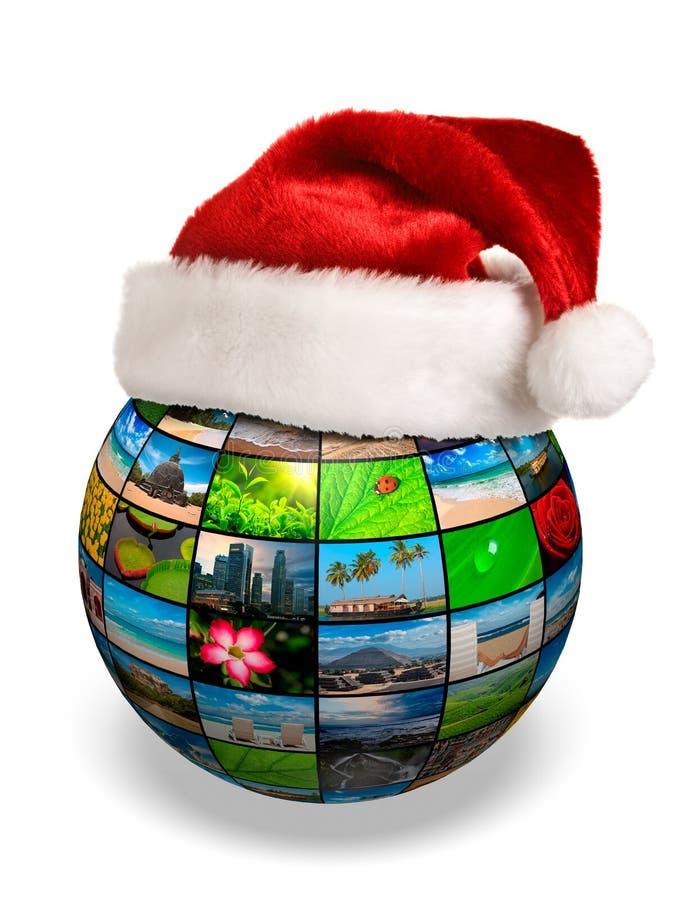 Concept de Noël - globe de photo dans le chapeau de Santa images stock