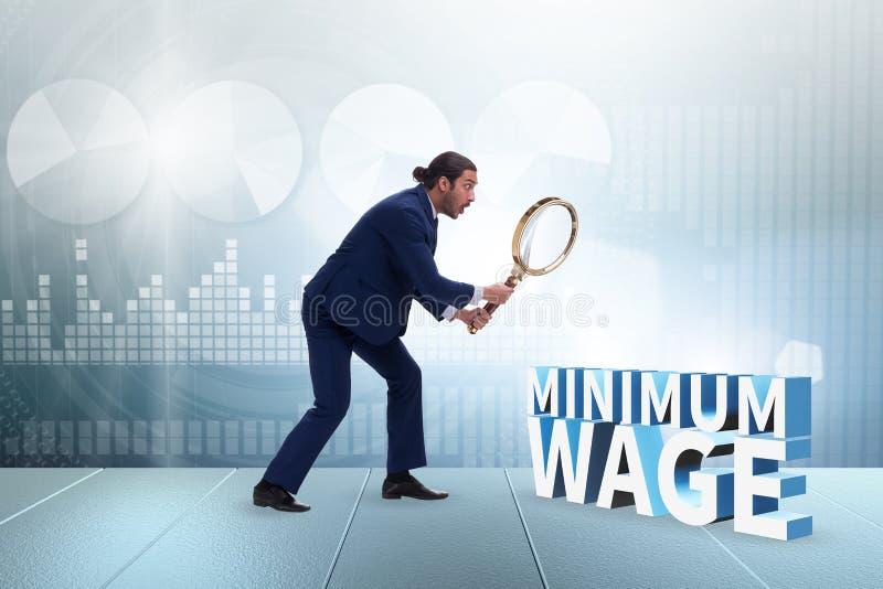 Concept de salaire minimum avec un homme d'affaires images libres de droits