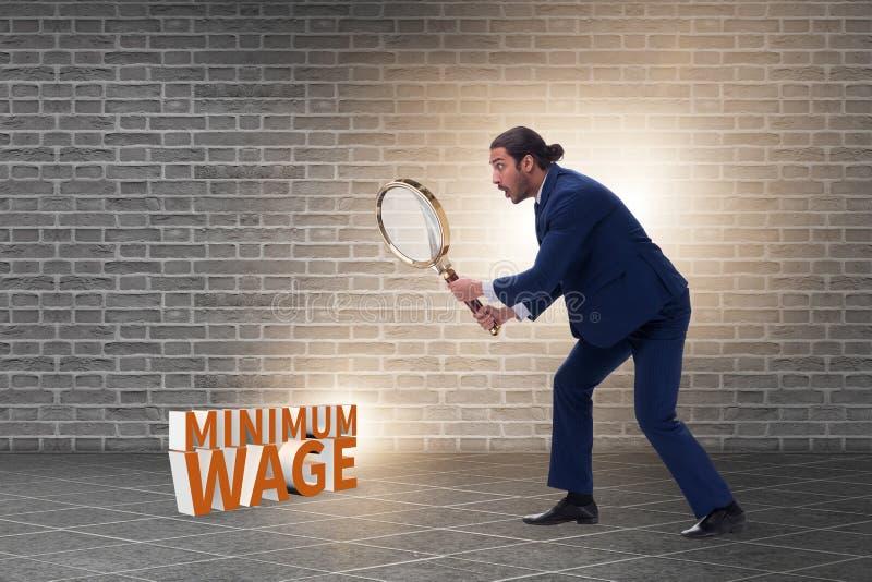 Concept de salaire minimum avec un homme d'affaires photographie stock