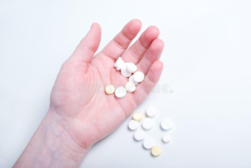 Concept de soins de santé. pillule dans la main. photos libres de droits