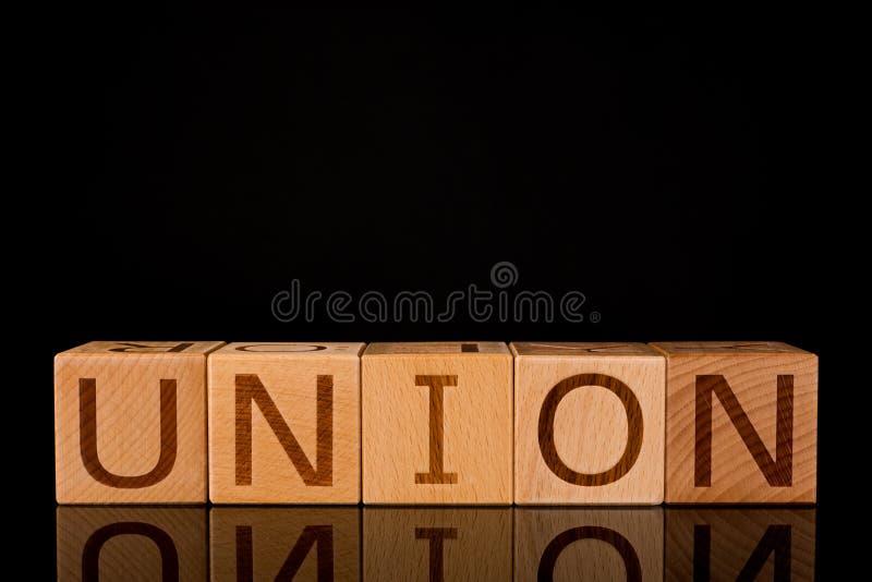 """Concept de travail d'équipe, bloc en bois de cube avec le  d'""""UNION†de mot images libres de droits"""
