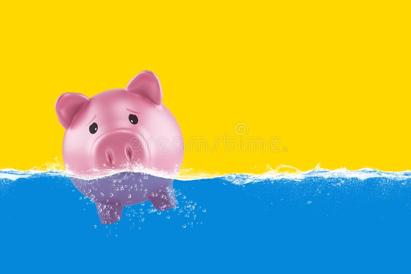 Lonely piggy bank sails in bad waters due to the crisis stock photos