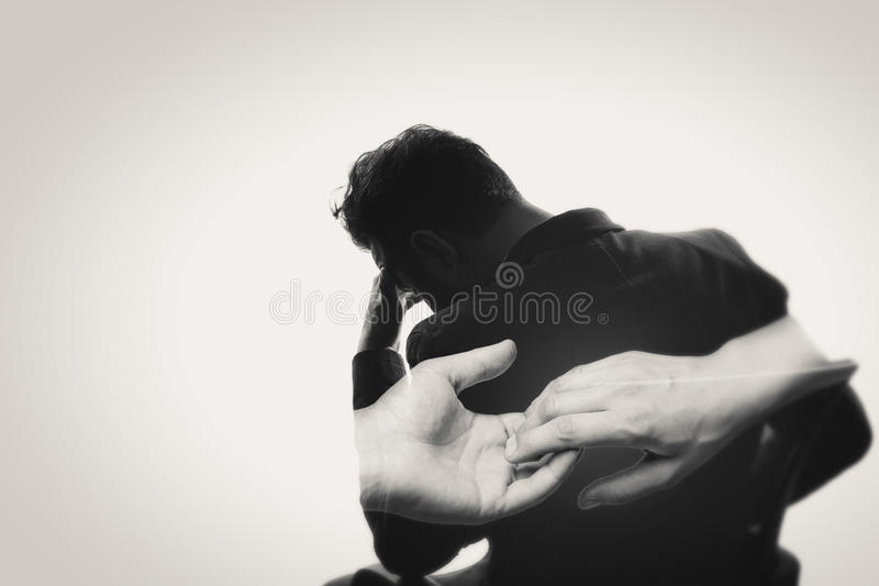 Concept, depicting parting. Black and white. Concept, depicting parting. Black and white image created using multiple exposures. The photo silhouette upset man royalty free stock image